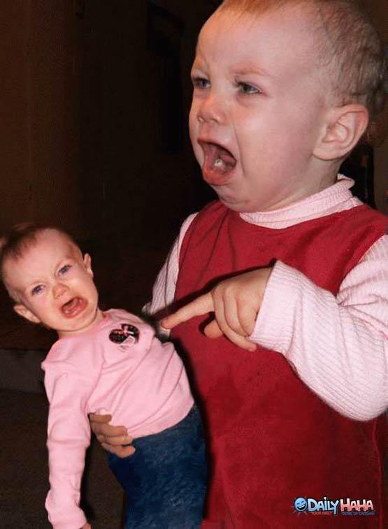 Baby angry at Doll