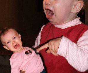 Baby angry at Doll