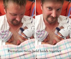 born holding hands funny picture