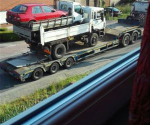 funny truck carrying car tow funny picture