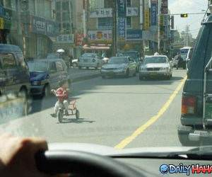 Tricycle in Traffic funny picture