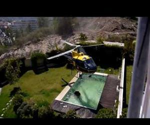 Amazing helicopter pilot taking water from swimming pool Funny Video