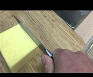 Making chainsaw noises while cutting cheese Funny Video