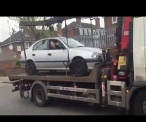 drives his car off tow truck Funny Video