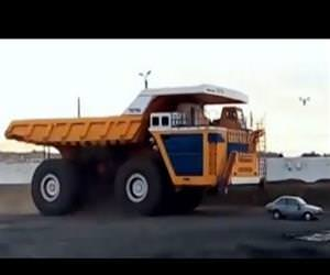 dump truck versus car Funny Video