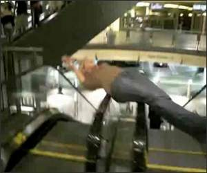 Escalator Spinner Girl