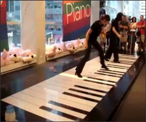 Girl plays giant piano Funny Video