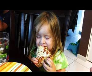 little girl falls asleep eating pizza Funny Video