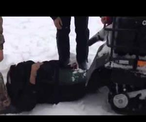 russian sucked into a snowmobile Funny Video