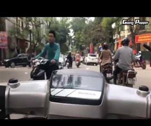 weaving through the city on a scooter Funny Video