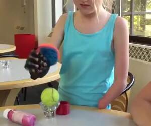 8 year old trying out her bionic arm for the first time