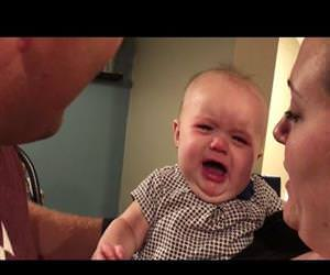 baby hates when mom and dad kiss Funny Video