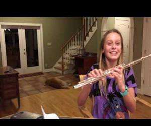 dog singing along to the flute Funny Video