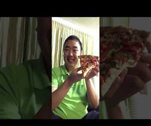 man eats an entire slice of pizza in one bite Funny Video